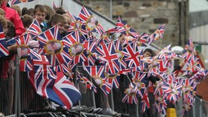 Crowd waving Union flags