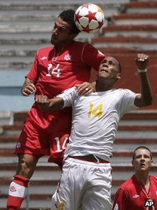 Canada's De Rosario, left, and Cuba's Alianni Urgelles in a World Cup qualifier on  8 June in Havana