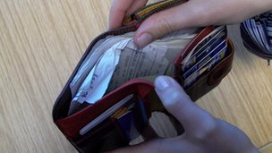 Woman opening a wallet