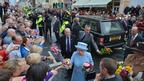The Queen accepts flower bouquets
