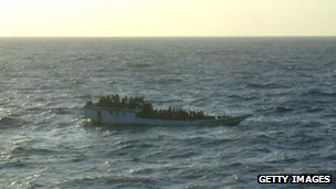 In this handout photo provided by Australian Maritime Safety Authority, a boat carrying 150 suspected asylum seekers is spotted prior to the vessel sinking north of Christmas Island, on 27 June, 2012.
