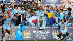 Manchester City players celebrate with the Barclays Premier League trophy