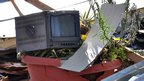 A damaged TV monitor at Ikhbariya satellite television station in Syria