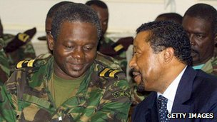 Coup leader negotiates with Gabonese foreign minister Jean Ping, right