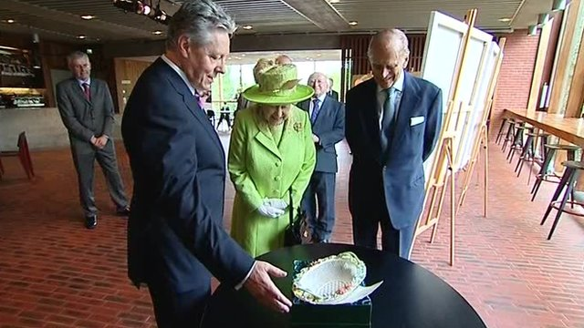 Peter Robinson, the Queen and the Duke of Edinburgh at Belfast's Lyric Theatre