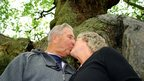 Sheila and Richard Walters kissing at the Major Oak