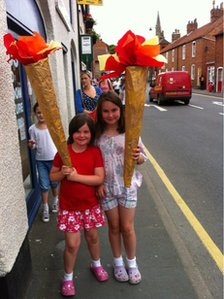 Freya and Lucy with their homemade torches