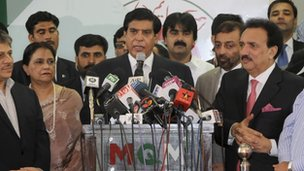 Pakistani Prime Minister Raja Pervez Ashraf, centre, briefs the media in Karachi on Monday, 25 June 2012