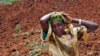 A woman cries for her four missing children, a day after the 25 June landslide in the Bududa district of eastern Uganda