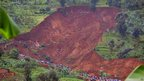 Aerial view of the mudslide that killed dozens of people in Bududa district, on the slopes of Mt Elgon, in western Uganda, on 25 June 2012.