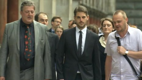 Paul Chambers arriving at court with Stephen Fry and Al Murray