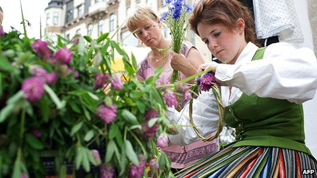 Women make wreaths for the festival