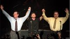 Bono holds up the hands of David Trimble and John Hume