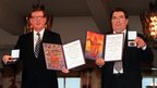David Trimble and John Hume with Nobel certificates