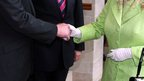 Close up of the Queen and Northern Ireland&#039;s Deputy First Minister Martin McGuinness shaking hands for the first time