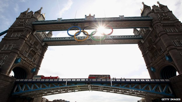 Olympic rings hang from Tower Bridge