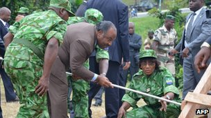 Gabonese President Ali Bongo (C) gets ready to set fire to the seized ivory