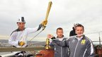 Alan Ellinson with the torch at the top of the Royal Dock Tower