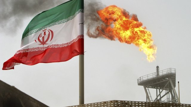 Oil production platform with an Iranian flag in the foreground, 1,250 km south of Tehran