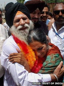 Surjeet Singh hugs his daughter Parminder Kaur