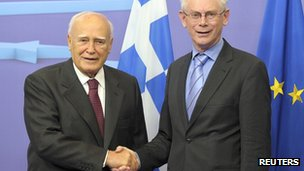 European Council President Herman Van Rompuy poses with Greek President Karolos Papoulias (L) before their meeting at the EU Council in Brussels on 27 June 2012
