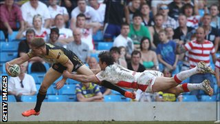 Sam Tomkins scores a try for Wigan against St Helens in May