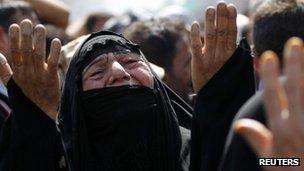 Shia pilgrim mourns at the Imam Moussa al-Kadhim shrine in Baghdad's Kadhimiya district June 16 2012