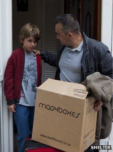 Man and boy leaving a house