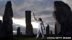 Kirsty Wade with Olympic torch at Callanish Standing Stones