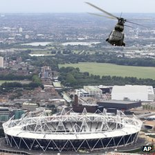 A Royal Air Force helicopter flying over the Olympic Stadium