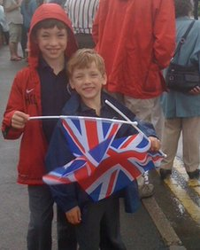 Nicola's sons wait for the torch
