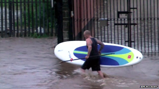 Surfer in floodwaters