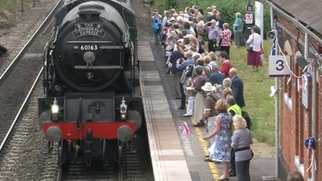 Steam train arriving at Goring and Streatley station