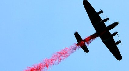 Lancaster bomber dropping thousands of poppies