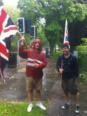 Two men waiting for the torch in Grantham
