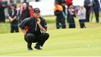Belfast player Michael Hoey lines up a putt in his first round of 70