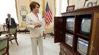 Nancy Pelosi watches TV's