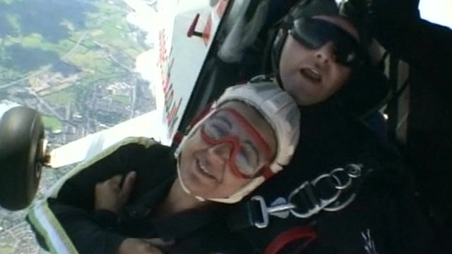 Paul Nicol (behind) in doing a tandem skydive
