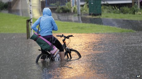 Cyclist caught in flood