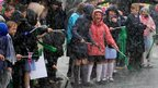 Schoolchildren in Mansfield brave the rain