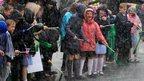 Schoolchildren in Mansfield brave the rain