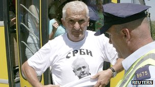 A Serb man with a t-shirt showing Slobodan Milosevic