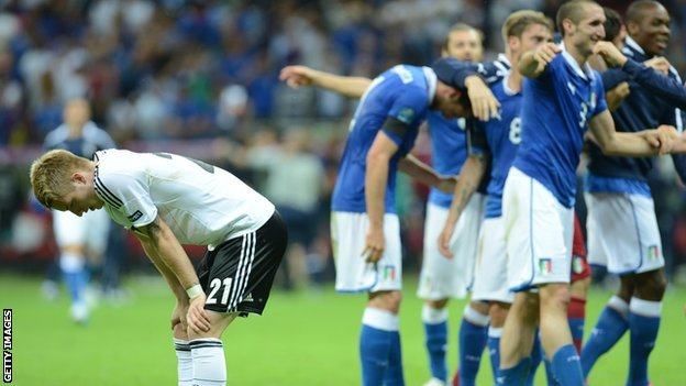 German midfielder Marco Reus is distraught as Italy's players celebrate