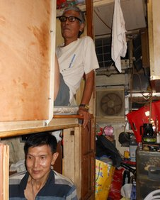 "Mr Wong (above) and Mr Lee live in bunk bed accommodation called ""coffin homes"""