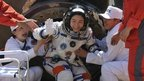 China's first female astronaut Liu Yang as comes out of the re-entry capsule of the Shenzhou-9 spacecraft