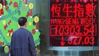 A man looks at the closing number of the Hang Seng Index in Hong Kong, 05 January 1998