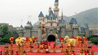 A traditional dragon is performed during the opening ceremony of Hong Kong Disneyland theme park, 12 September 2005