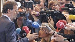 Mariano Rajoy talks to reporters
