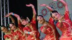 Dancers on stage at Glasgow Mela
