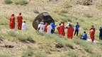 Members of the search team approach the re-entry capsule of Shenzhou-9 spacecraft in Siziwang Banner of Inner Mongolia region in northern China, 29 June 2012